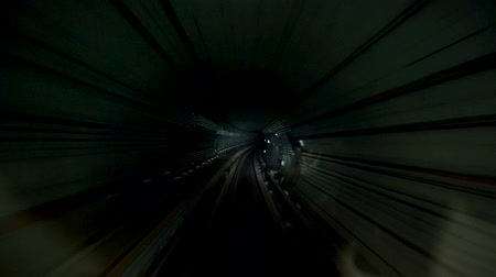 Subway Train Slowly Driving Through Dark and Creepy Tunnel
