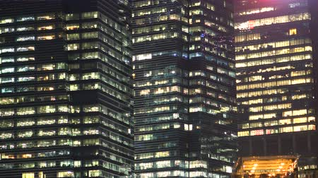 Modern Office Skyscraper Buildings and Glass Windows at Night