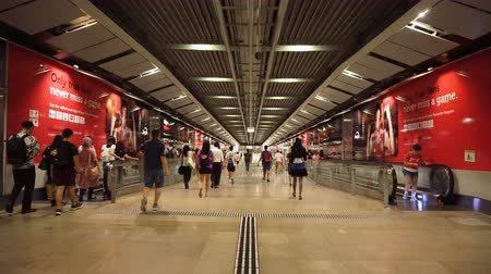 Commuters Using Moving Walkways at Underground Station in Singapore - August, 2019 Dostupné videozáznamy