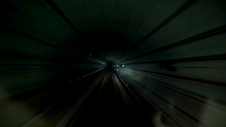 Motion Timelapse of Subway Train Driving Through Dark Tunnel