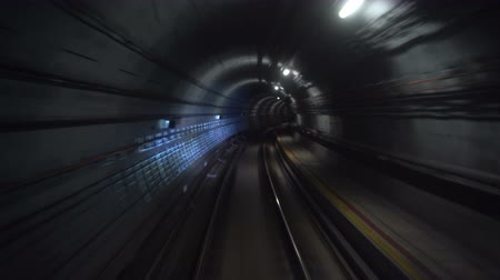 Motion Timelapse of Metro Train Driving Through Subway Tunnel