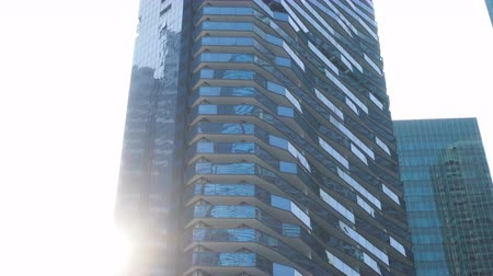 upward : Glass Windows and Balconies of Tall Modern Skyscraper Luxury Condominium Building Stock Footage