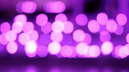 Purple abstract bokeh background of light from Thai lanna lantern at night.  Concepts of celebration in Yi Peng Festival. 動画素材