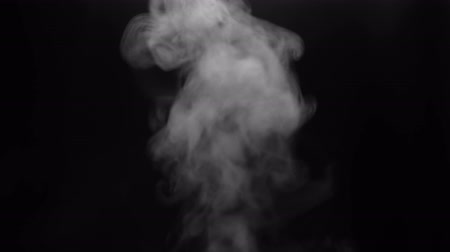 Close up of white steam smoke shot up on a black background. Concept of abstract backdrop.