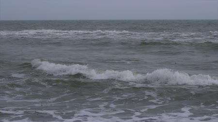 Ocean waves in slow motion. Storm in the ocean. Large sea waves in slow motion