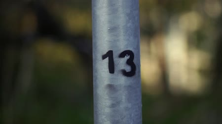 dozen : The number is thirteen. The inscription number 13 on the iron pipe. Stock Footage