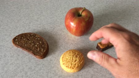 Human hand making choice among different food