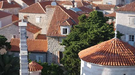 Черногория : view from top to the Budva old city with sound Church bells ringing. Camera moves from left to right