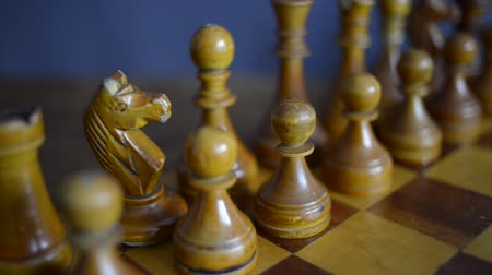 vintage chess set up on wooden chessboard, slide camera movement