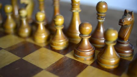 vintage chess set up on wooden board, slide camera movement
