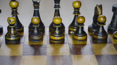 vintage wooden black chess set on board, sliding camera movement Dostupné videozáznamy