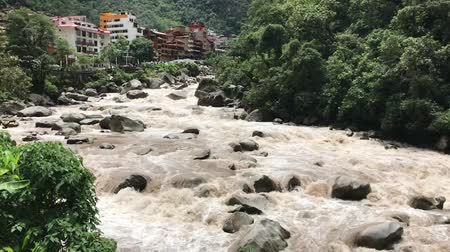 назад : wild Urubamba River in Peru with Aguas Calientes town on backward, panoramic footage with natural sound