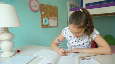 реализация : successful implementation homework. happy girl learning mathematics lessons. Стоковые видеозаписи