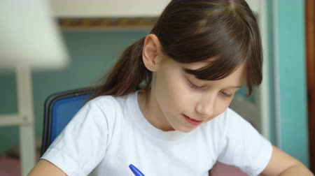 реализация : joy learning homework. successful implementation homework. pleased pupil studying mathematics lessons.