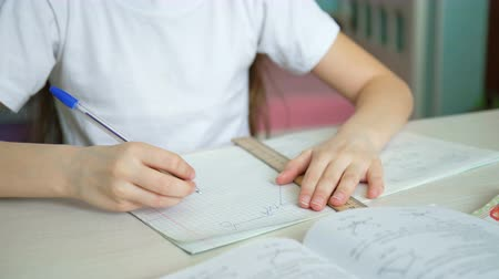 frustrado : schoolgirl learning homework. pleased pupil studying mathematics