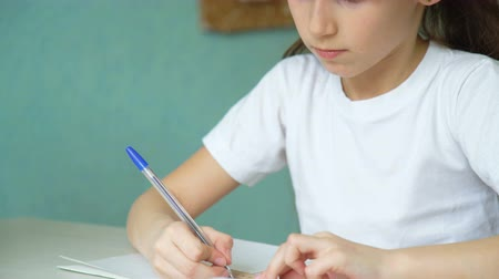 implementation : girl learning lessons homework. pupil emotional studying at home
