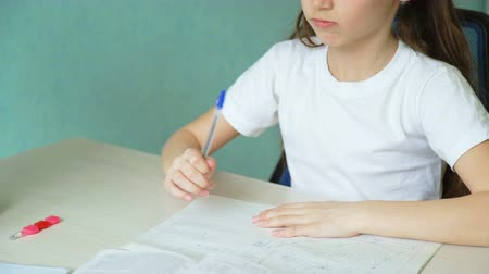 реализация : Difficulties in homework. Stressed girl learning mathematics lessons. Tired child sleeping table solving equation