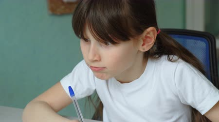 implementation : successful home education. Cute girl learning homework, closeup