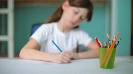 sharpener : closeup girl hands sharpening pencil, cinemagraph, kid prepare to home exercise Stock Footage