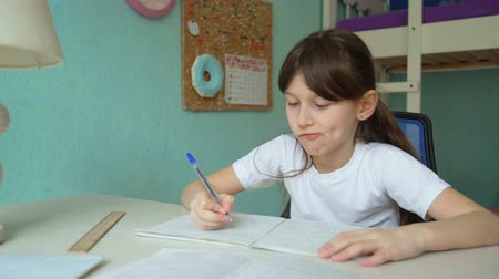 puericultura : disappointment home education. dissatisfied girl throw notebook Stock Footage