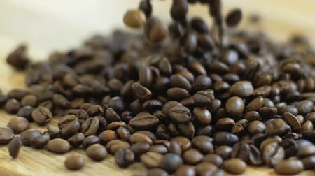 americano : Loading and unloading operations. Roasted Coffee beans spreading cutting board. Slow motion Stock Footage
