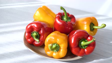 tempero : Colored red yellow Bell Pepper Placed on plate. white shaddow background. Healthy eating and lifestyle
