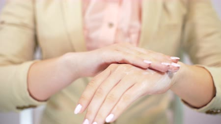 womans hand : Beautiful womans hands applying cream. Female applying moisturizer to her hands. Skincare, beauty, wellness, healthcare concept
