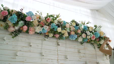 romance : Flowers event wedding decoration. Beautiful florist creating spring colorful bouquet arrangement. Process of preparing floral composition for celebrating party.