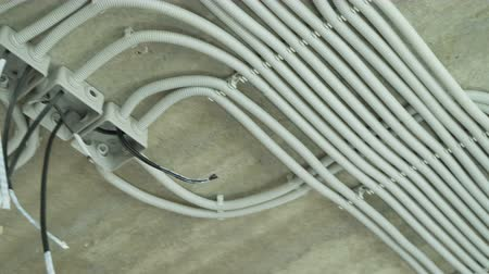 ремонт : Electrical installation of plastic tubes on building site. Fix boxes, fire prevention cable tray wiring channels indoors, excellent electrical insulation. Living rooms electricity network connection Стоковые видеозаписи