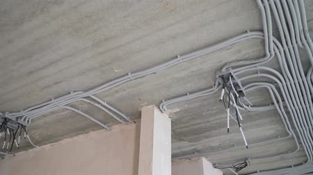 elektryk : Electrical installation of plastic tubes on building site. Fix boxes, fire prevention cable tray wiring channels indoors, excellent electrical insulation. Living rooms electricity network connection Wideo