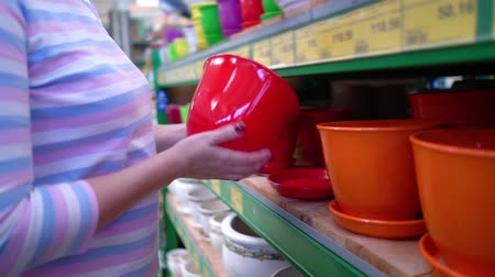по уходу за телом : Caucasian woman near shop shelve choosing ceramic pot for household in store closeup. female customer checking product assortment. sale, shopping, consumerism concept
