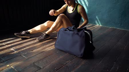 dövüş sanatları : Closeup young fit woman legs with blue bag entering fitness club and preparing for the boxing training. Health, wellness, fighting, motivation, martial arts, self defense and cardio workout concept