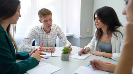 high school : high school students group working on project together on table in classroom. interactive education, communication, knowledge, development, study concept Stock Footage