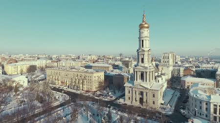 sobor : Aerial of urban landscape covered with snow, orthodox church Uspenkii Sobor. city buildings in winter
