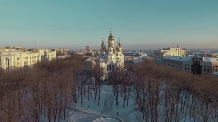 ortodoks : Kharkiv, Ukraine - Dec 13, 2016: Aerial of Zhon Myronosyts orthodox church, city park covered with snow. historical building