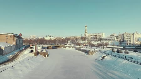 sobor : Kharkiv, Ukraine. Aerial of Lopan River covered with ice, Uspenskii Sobor. Sunny winter day Stock Footage