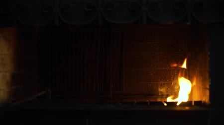 firebox : fire flames in traditional brick fireplace in the dark. warm, cozy, relax Stock Footage