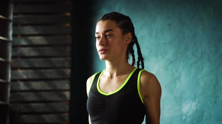 wrapped up : Slow motion young serious female boxer in wrapped hands warming up, jumping on skipping rope closeup Stock Footage