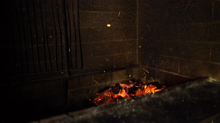 firebox : fire flames of burning wood in traditional brick fireplace in the dark Stock Footage