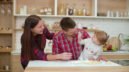 trzy : happy family having fun together in kitchen