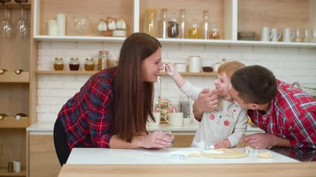 uç : happy family having fun with flour in kitchen Stok Video