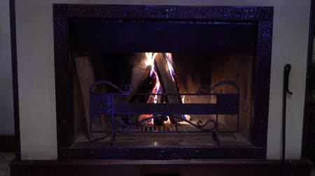 firebox : burning wood in traditional fireplace in the dark Stock Footage