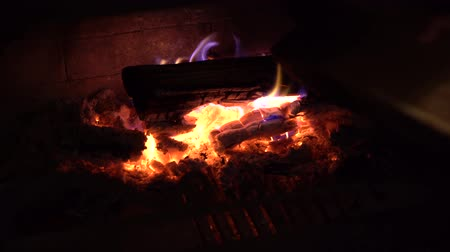 firebox : fire flames on wood logs burning in fireplace in the dark Stock Footage