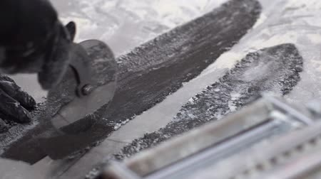 pasta cutter : hands in gloves cut rolled black dough with pizza knife closeup in slow motion Stock Footage