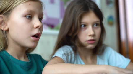 telephoto lens : little girls playing computer games on laptop Stock Footage