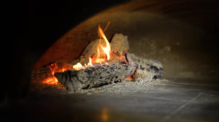firebox : wood logs burning in fireplace in the dark