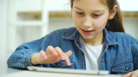 obsession : internet addiction by kid playing online games on tablet Stock Footage