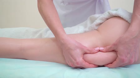 celulitida : anti cellulite massage on buttocks and legs of young woman closeup Dostupné videozáznamy
