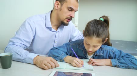 преподаватель : private tutor helping little school girl with studies