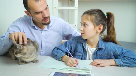 çözme : single parent family of father and daughter doing homework together and cat